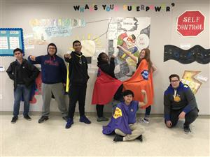 students wearing capes