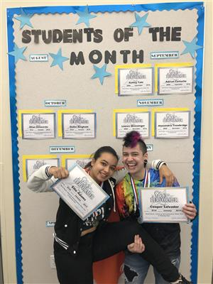 Students of the month - holding certificates