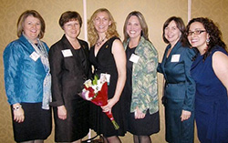 Photo of Shari Herout receiving the California Teacher of the Year Award in 2012