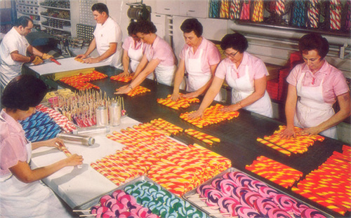 Historical photo of workers making candy sticks at the Nut Tree Candy Store